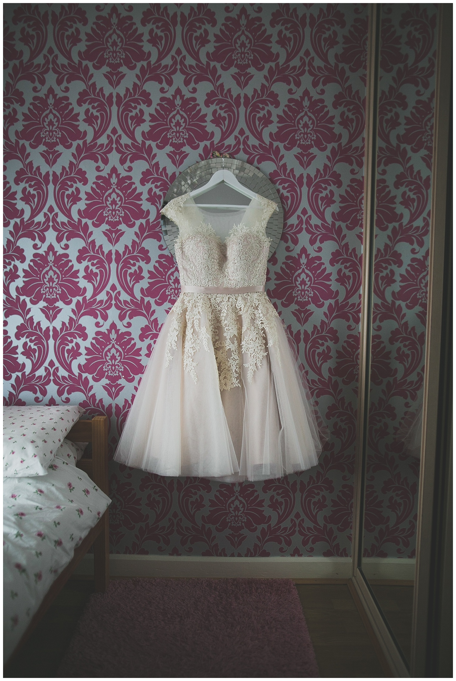 Off white tulle and lace wedding dress in a knee length skater style