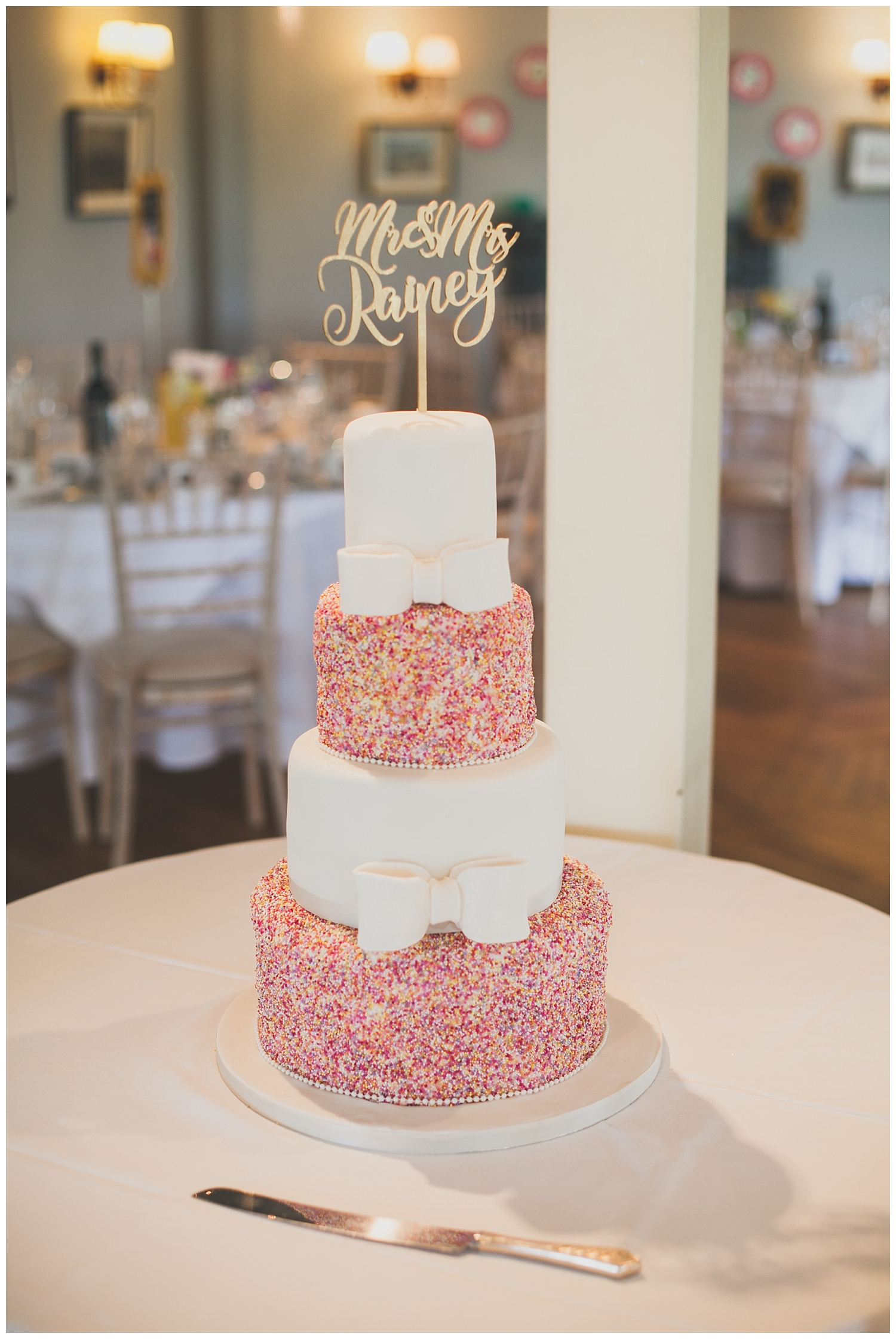 Brunch ice-cream style wedding cake covered in pink sprinkles