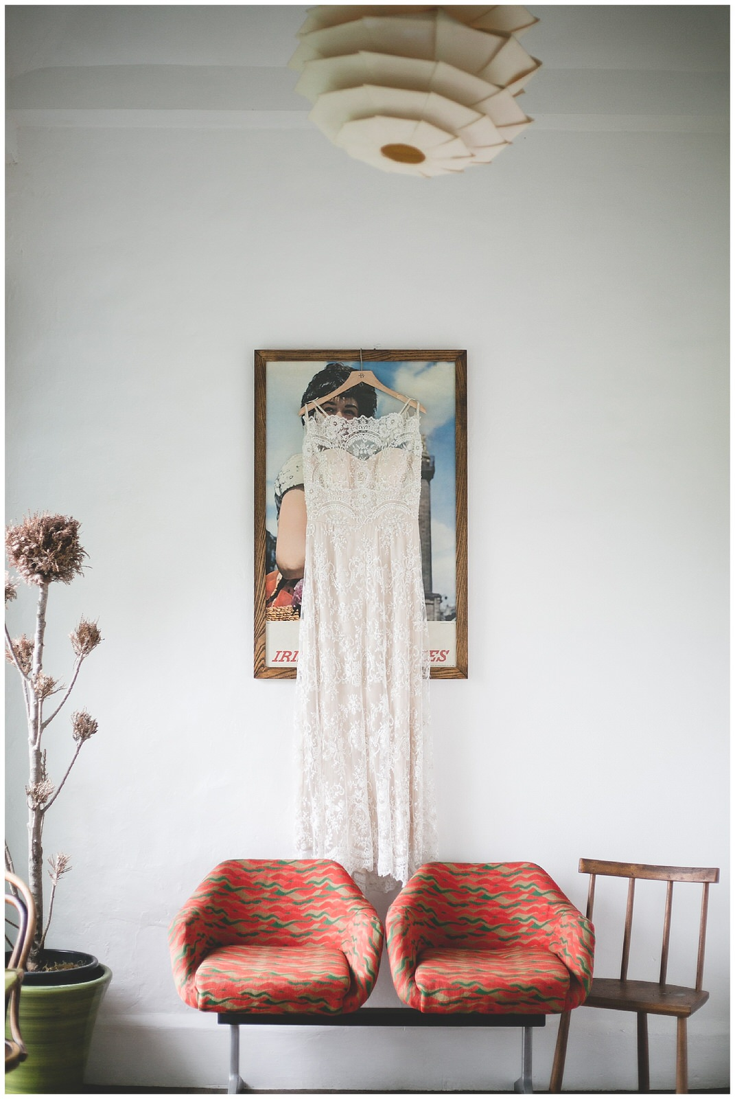 Sleevless white sequins wedding dress hanging in the airport waiting room at Bellinter House