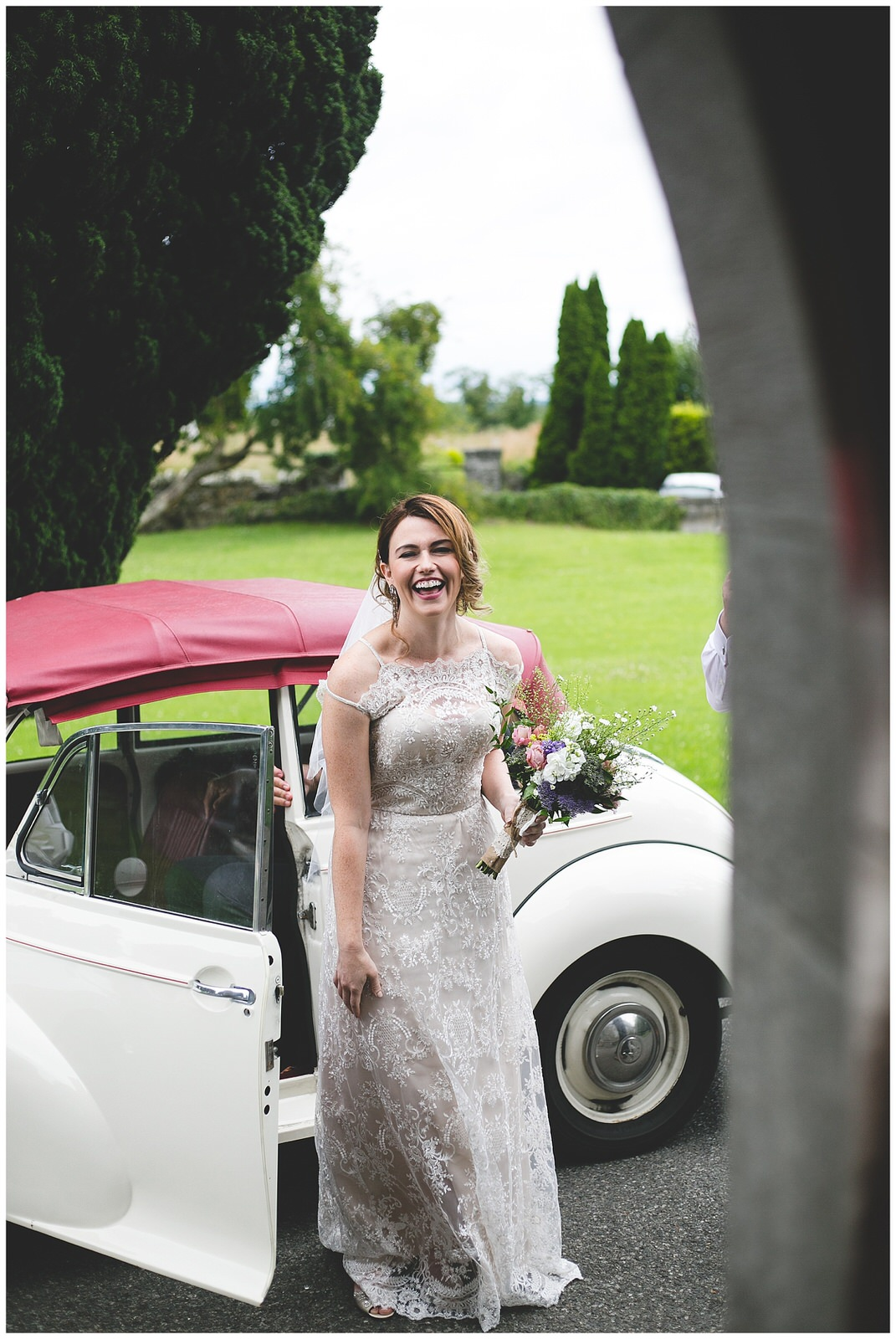 Bride smiling as she arrives at the church - Natural Dublin Wedding Photographer