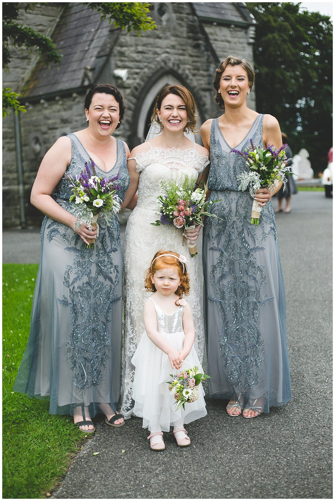 Gorgeous portrait of a bride, bridesmaids & flower girl
