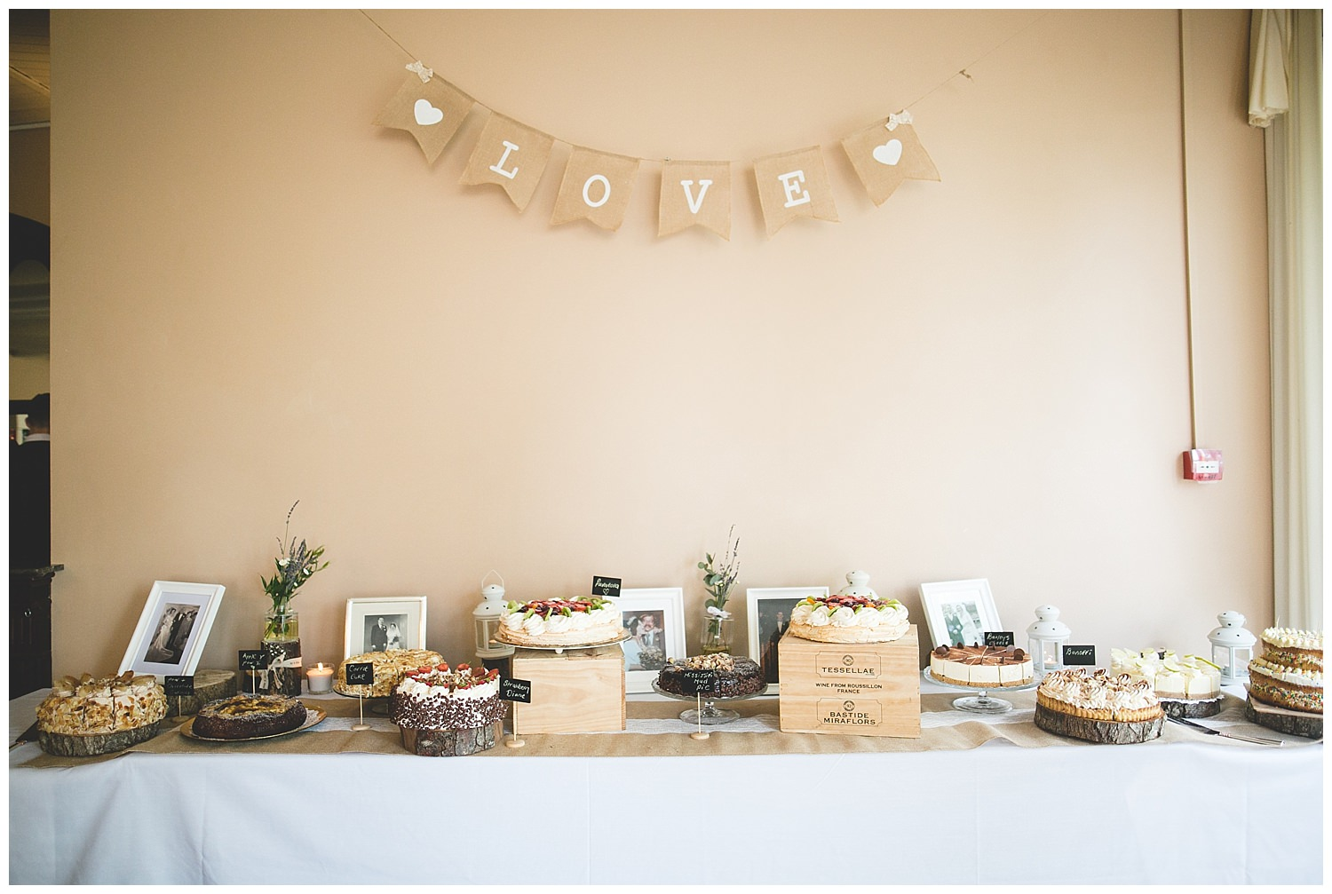 beautiful cake table with a selection of different bakes, cakes and treats