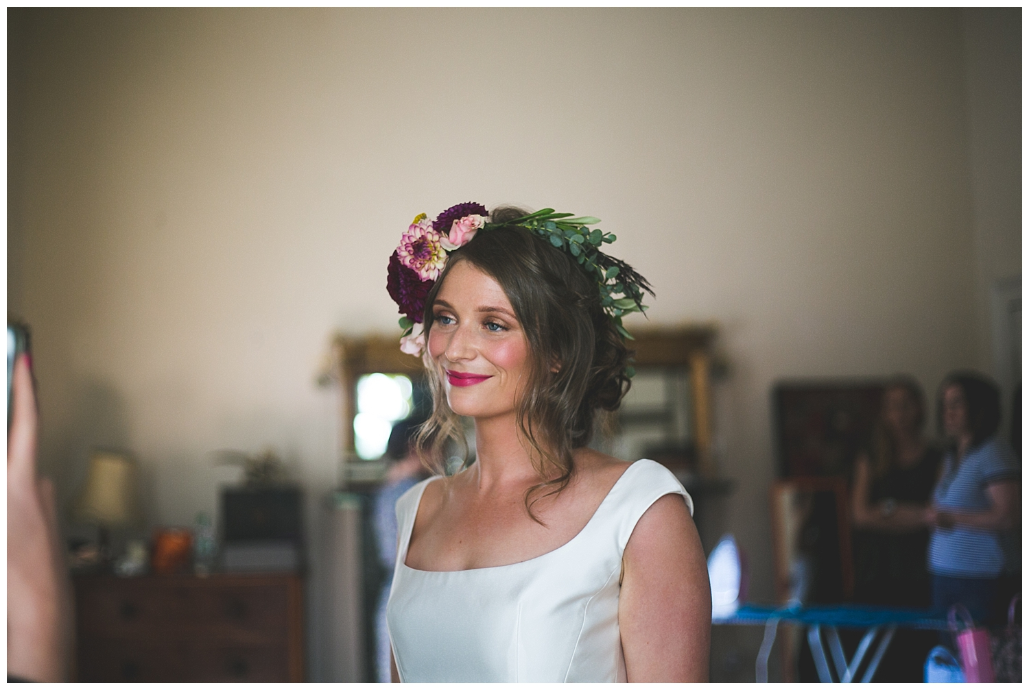 Gorgeous bride in a real floral crown with pink lipstick
