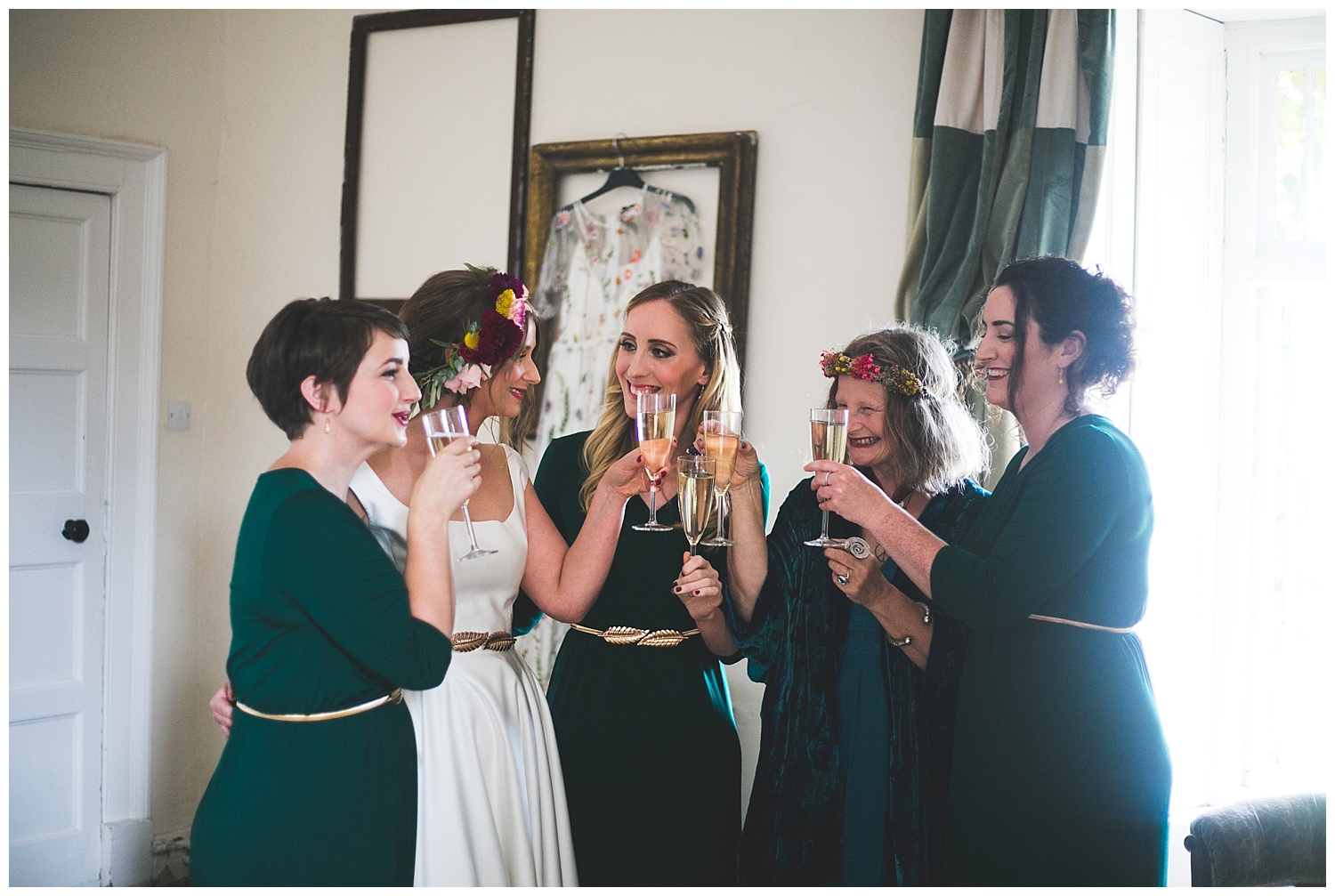 Bridesmaids and bride toasting with champagne