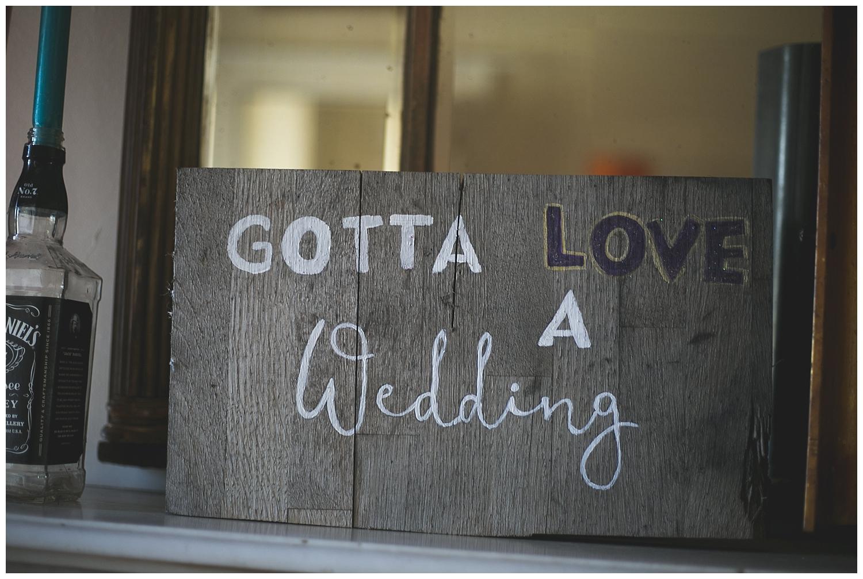 Gotta love a wedding - handprinted sign
