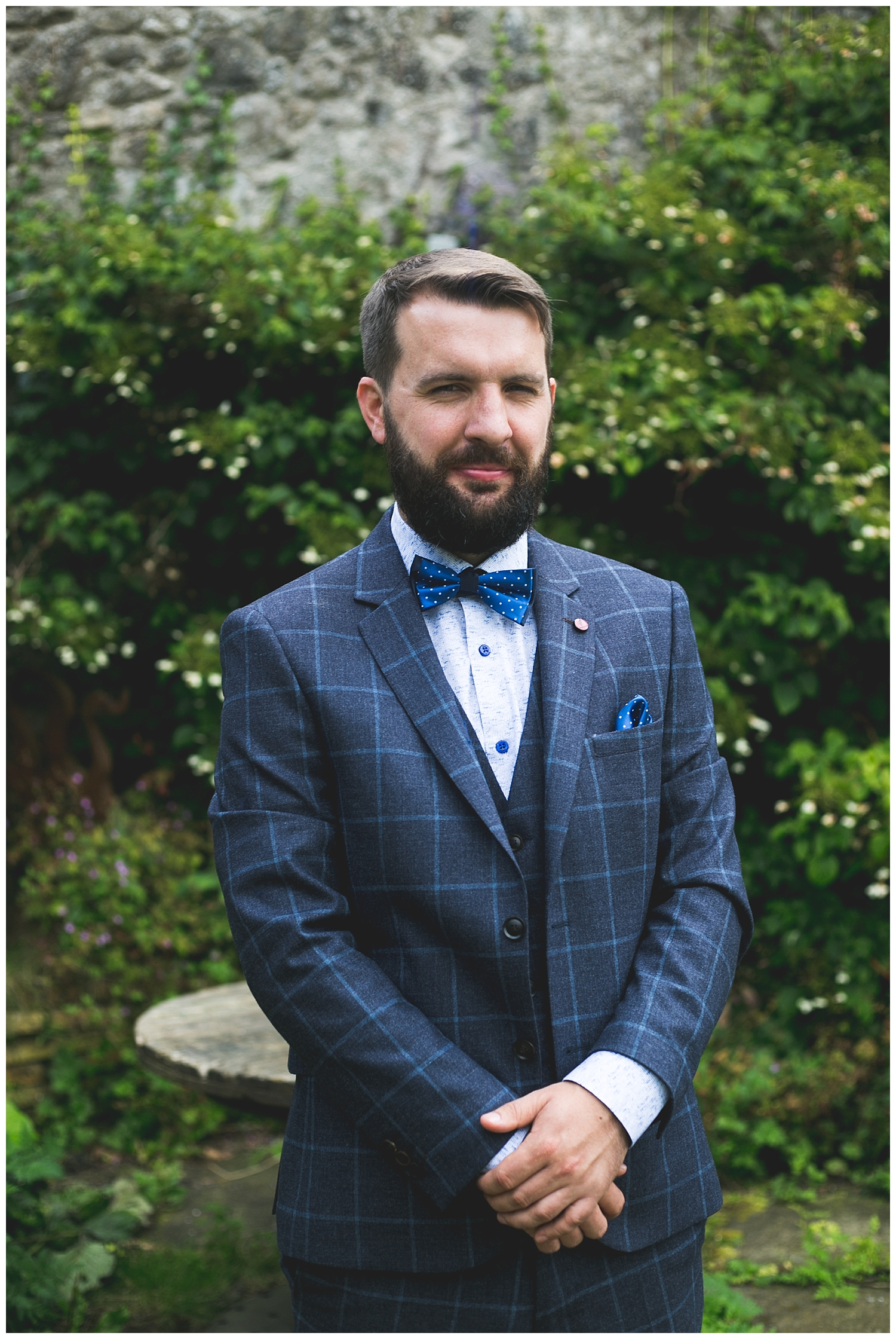 Groom in a dapper three piece blue and navy suit