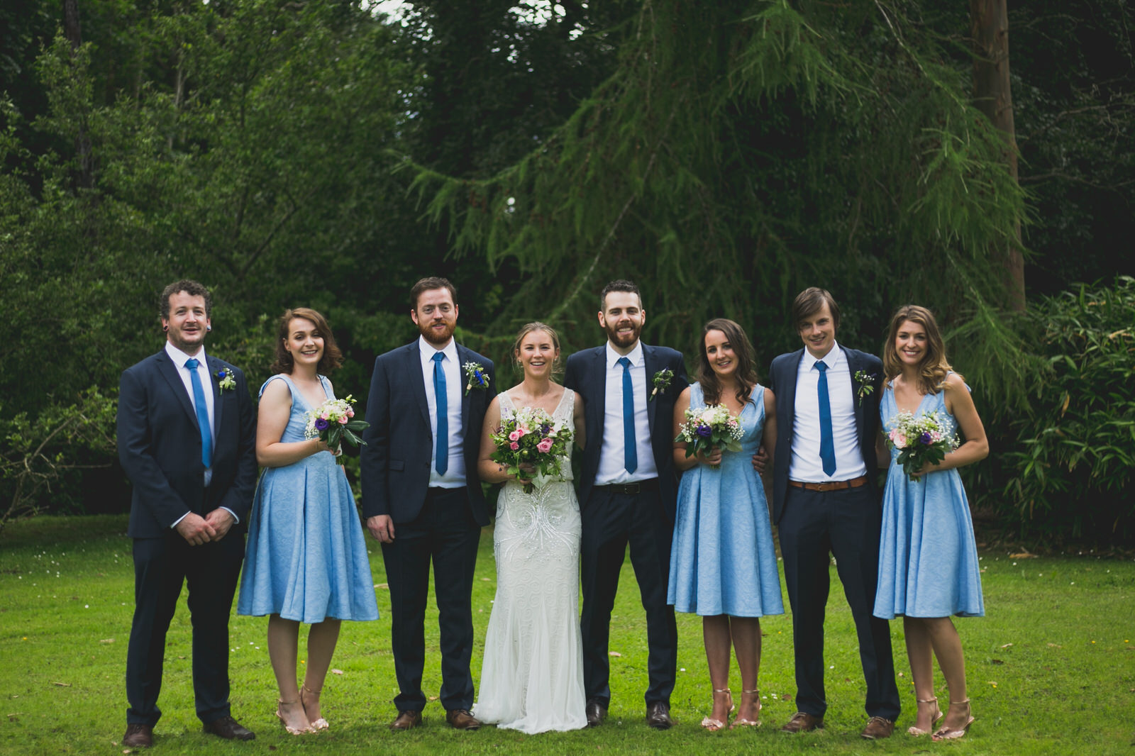 Blue and Navy bridal party portraits at a back garden wedding