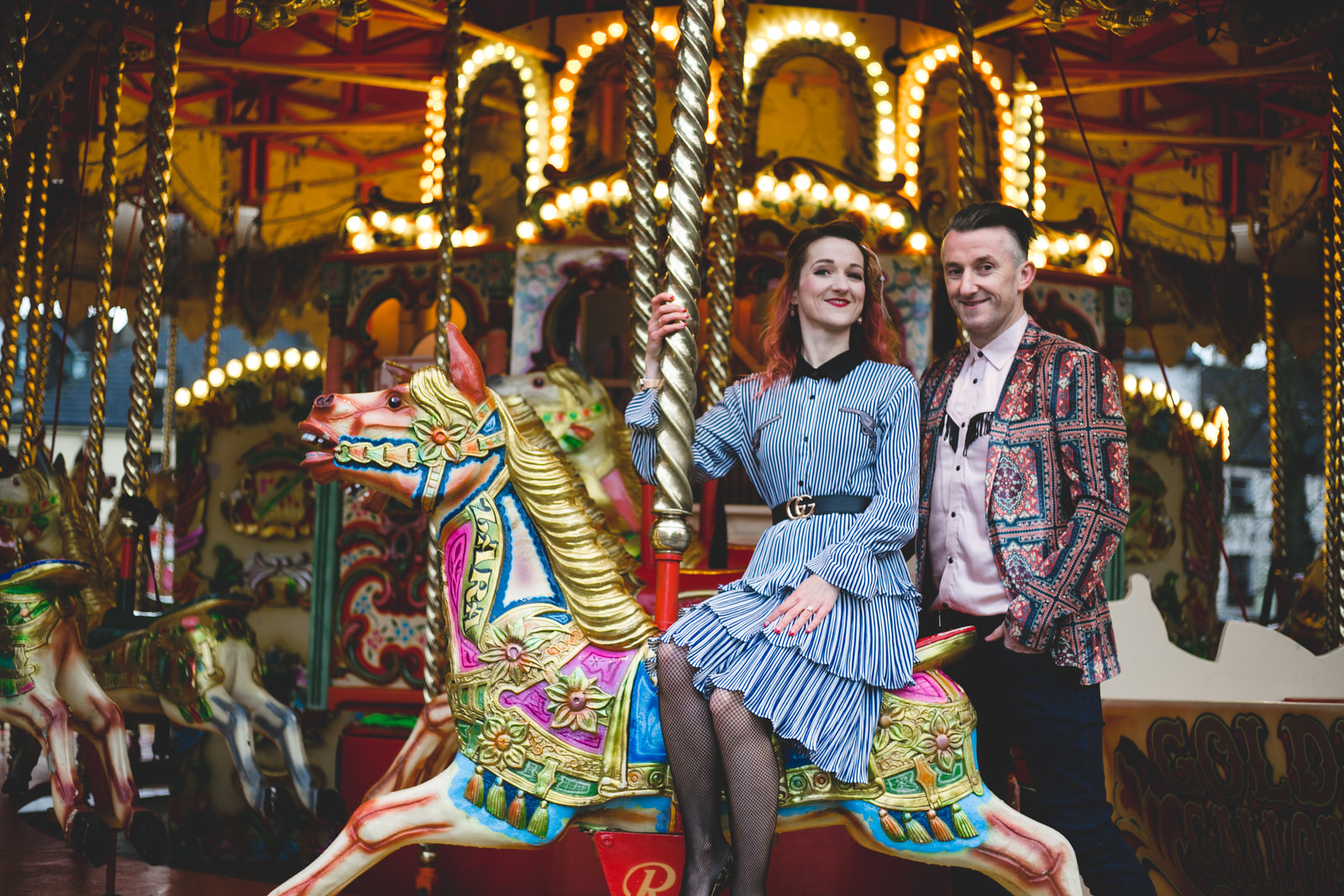 Super funky wedding couple on a fairground merry-go-round