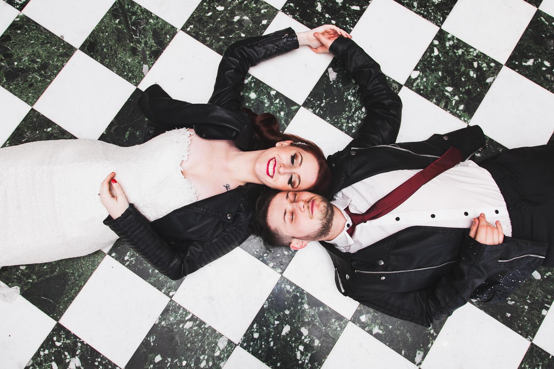 overhead shot of couple on black & white tiles