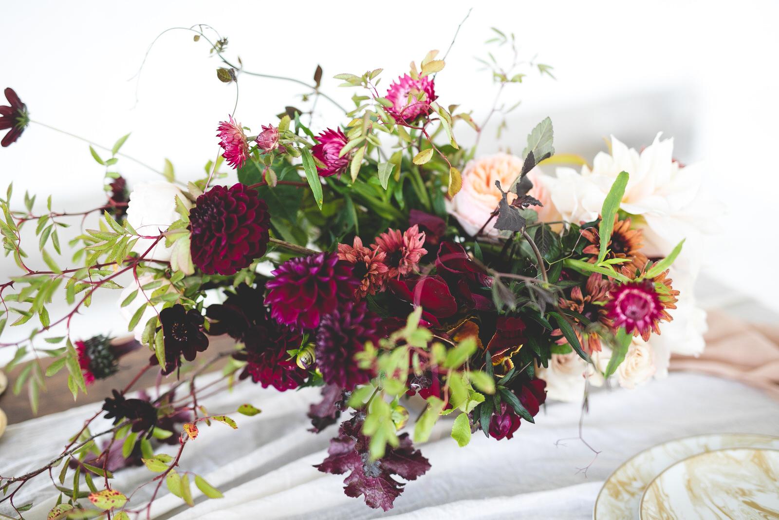 Wild burgundy & pale pink floral centrepiece