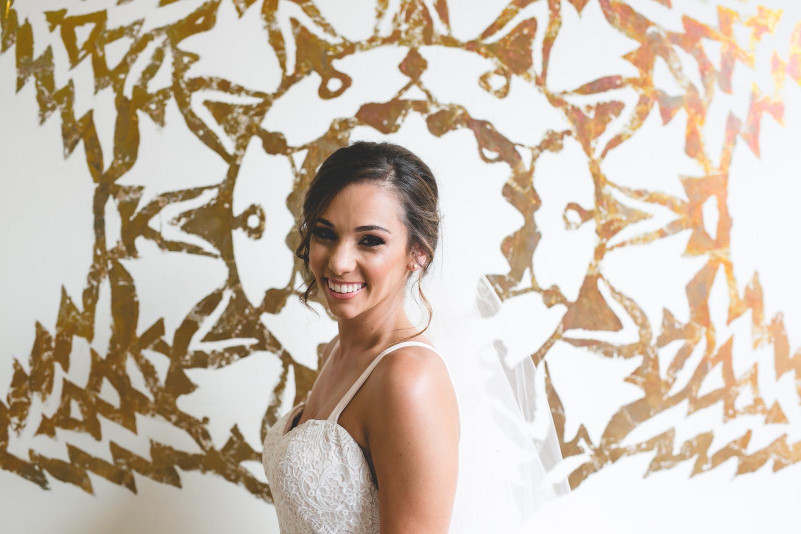 Bridal portrait at wall art in Kellys Hotel on Fade Street