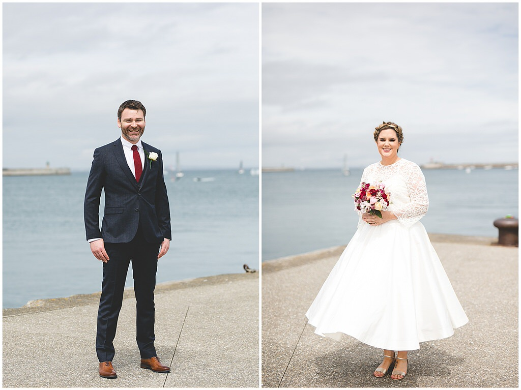 Full length portraits of the bride & groom by the seas