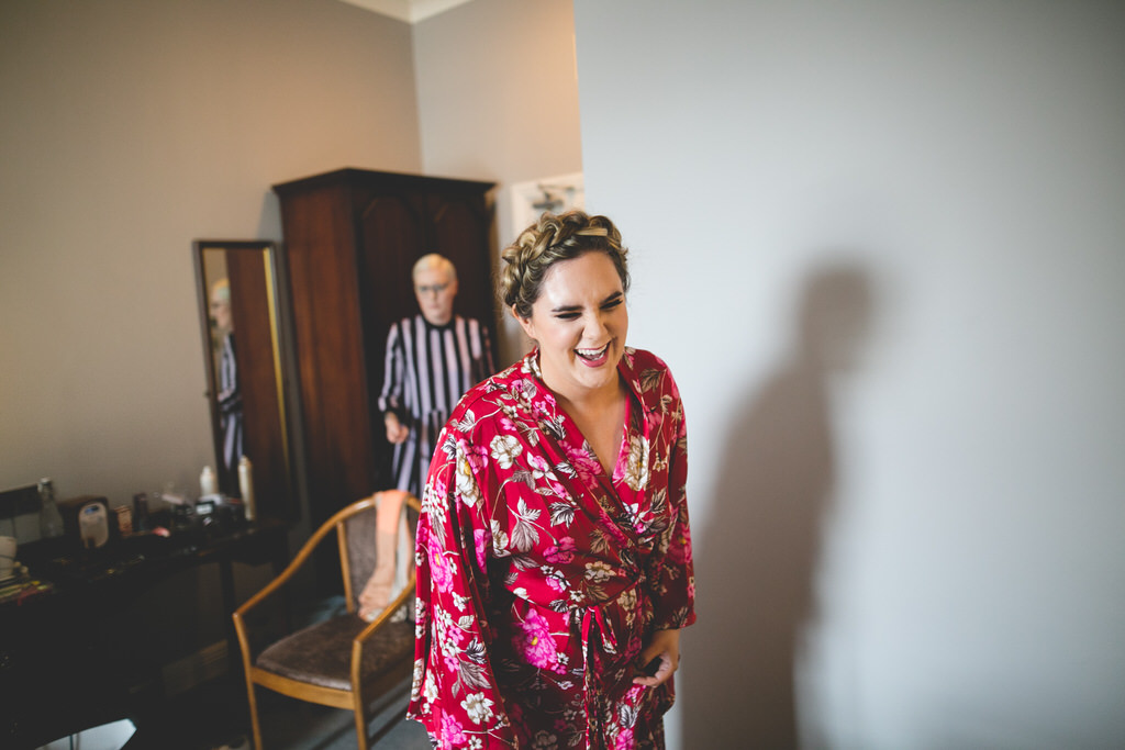bride in red floral kimono style dressing gown