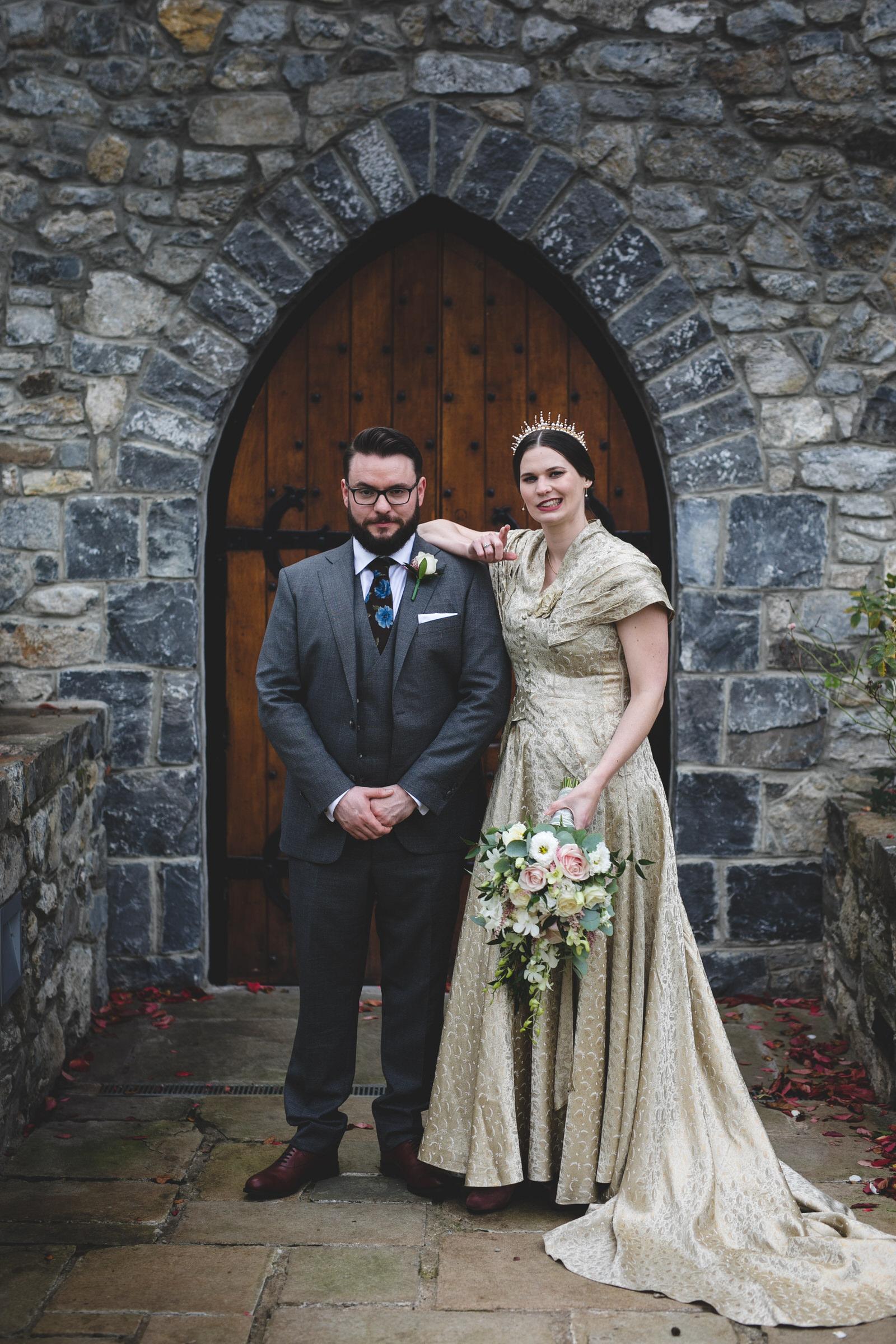 Fun wedding portraits at castle door in Barberstown castle Kildare