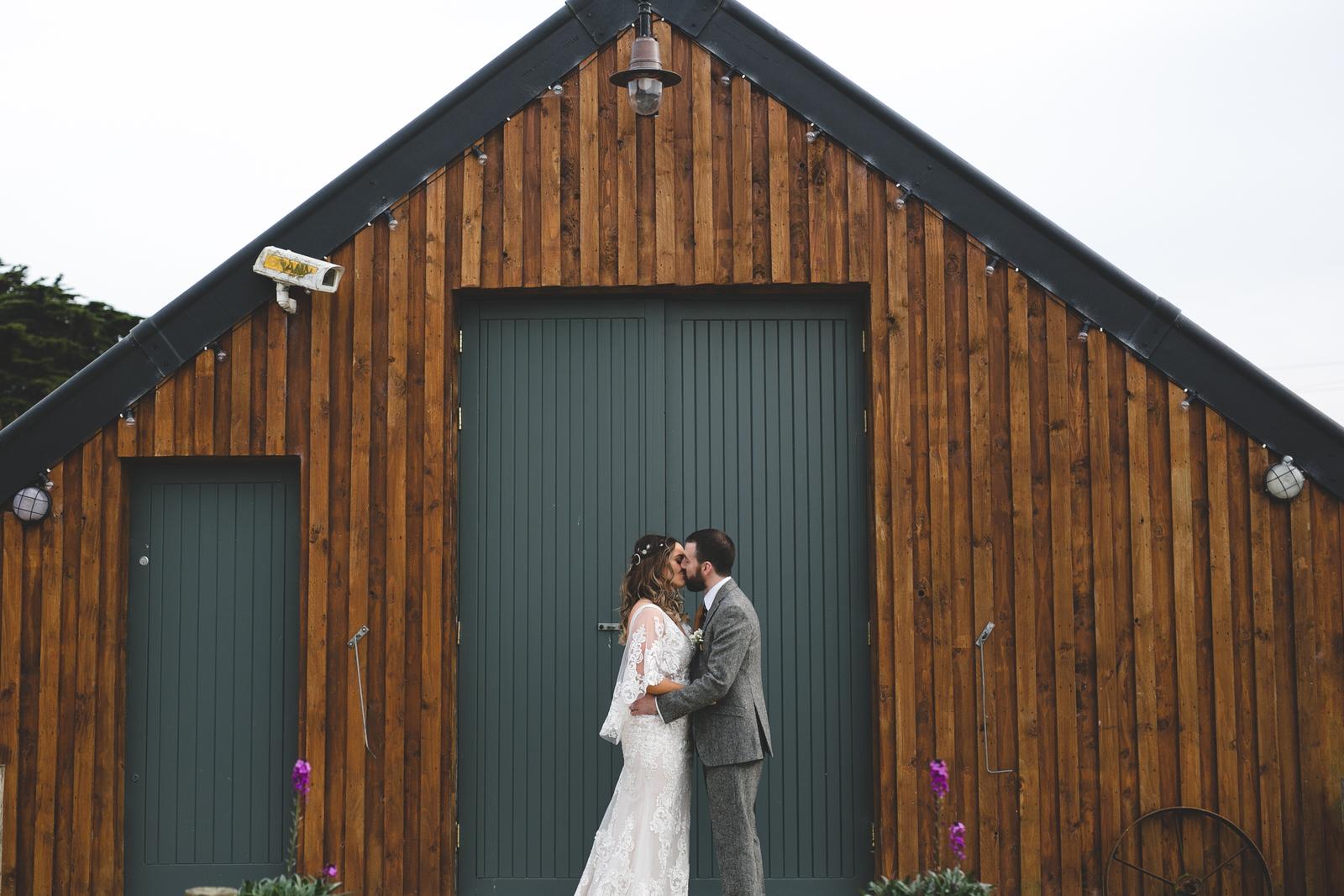 Cool brown bard backdrop at Seagrave barns
