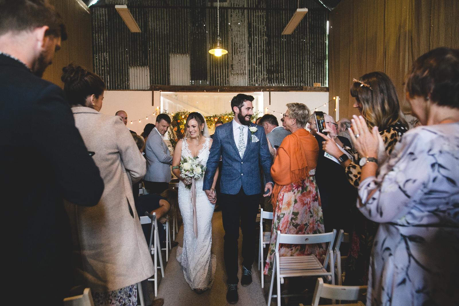 walking down the aisle at Cloughjordan House Wedding Venue