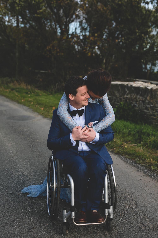 Stylish wheelchair wedding with a blue wedding dress