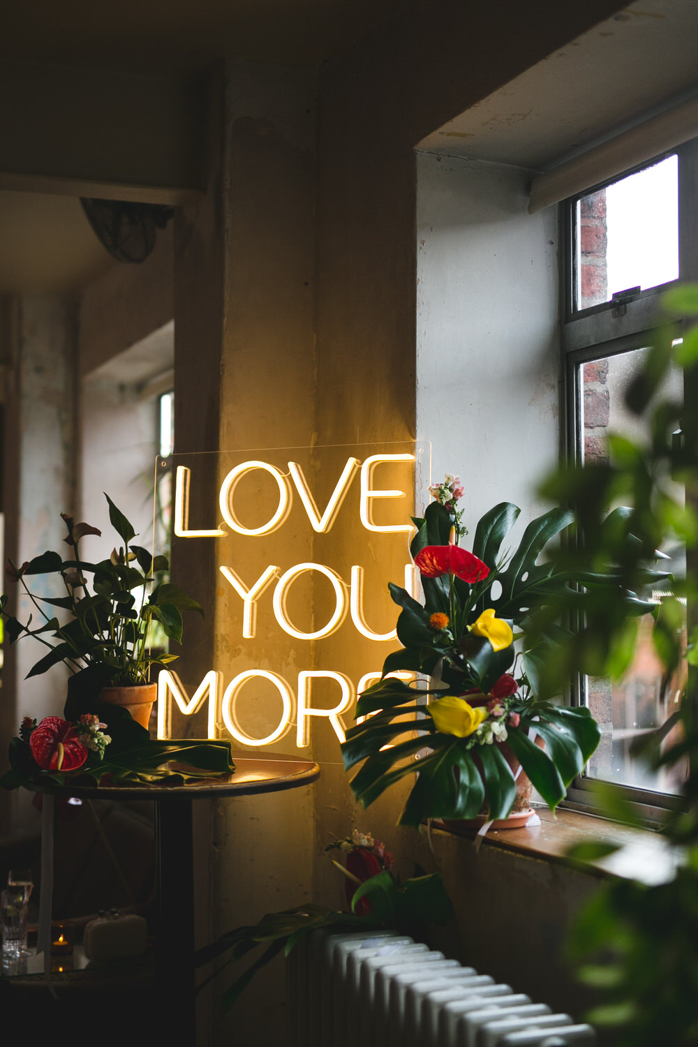 Love You More neon sign at Drury building wedding